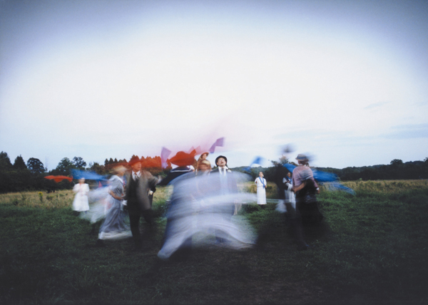 Actors perform in a field in 4th Line Theatre's production of Fair Play.