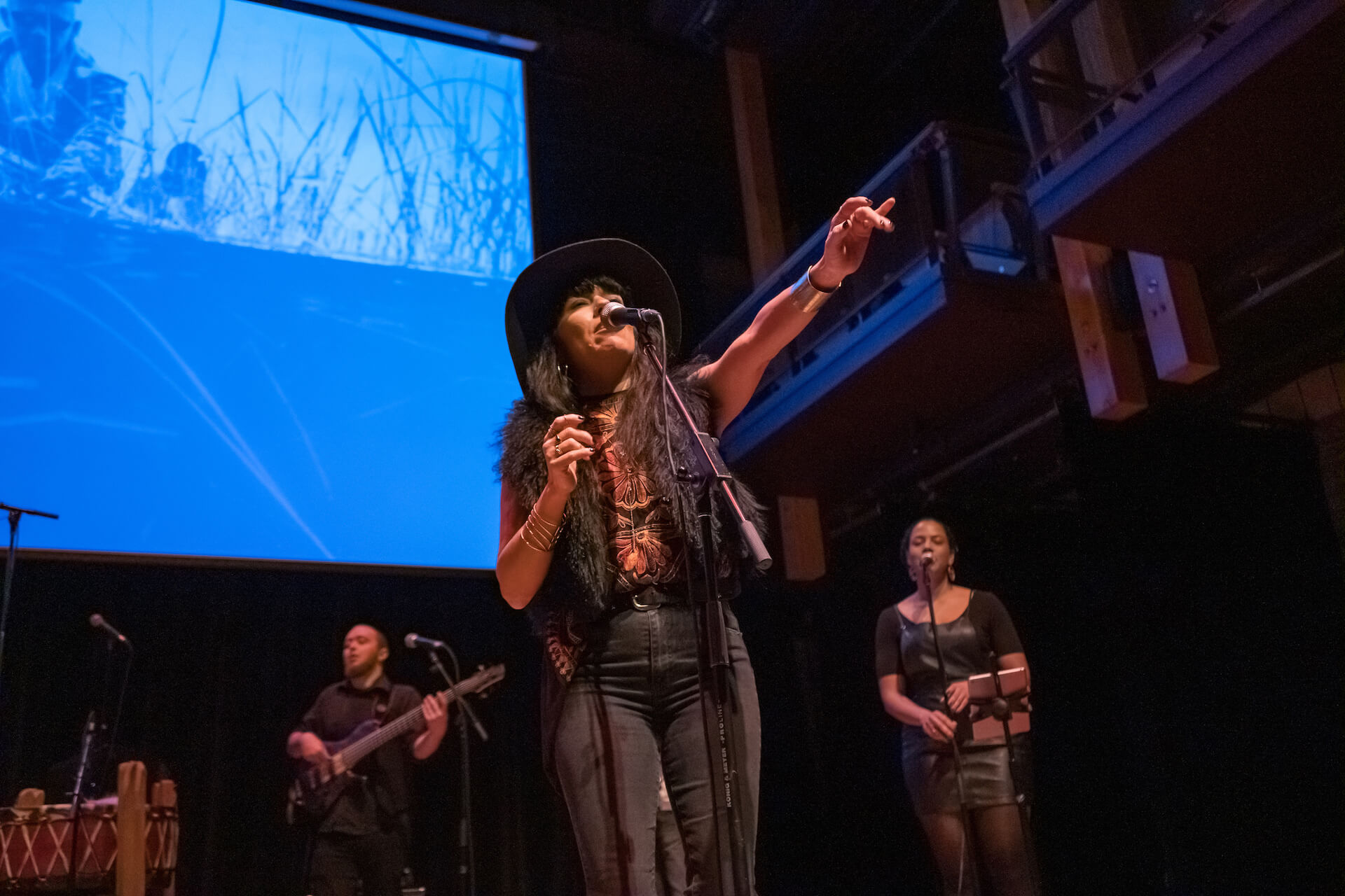 ShoShona Kish (centre) of Digging Roots performs during the Gchi Dewin Indigenous Storytellers Festival at the Charles W. Stockey Centre for the Performing Arts in Parry Sound, a co-presentation by MUSKRAT Magazine and ReZ 91.3 FM. (Photo: Robert Snache)