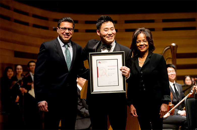 Earl Lee (centre), recipient of the 50th anniversary Heinz Unger Award, is joined by Ontario Arts Council board member Karim Karsan (left) and Toronto Symphony Orchestra board member Noelle Richardson (right).  (Photo: Jag Gundu/Toronto Symphony Orchestra)